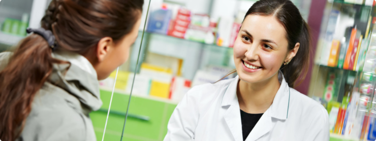 Woman Pharmacist talking with the customer
